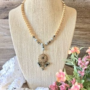 Handmade Beaded Necklace with Vintage Pendant